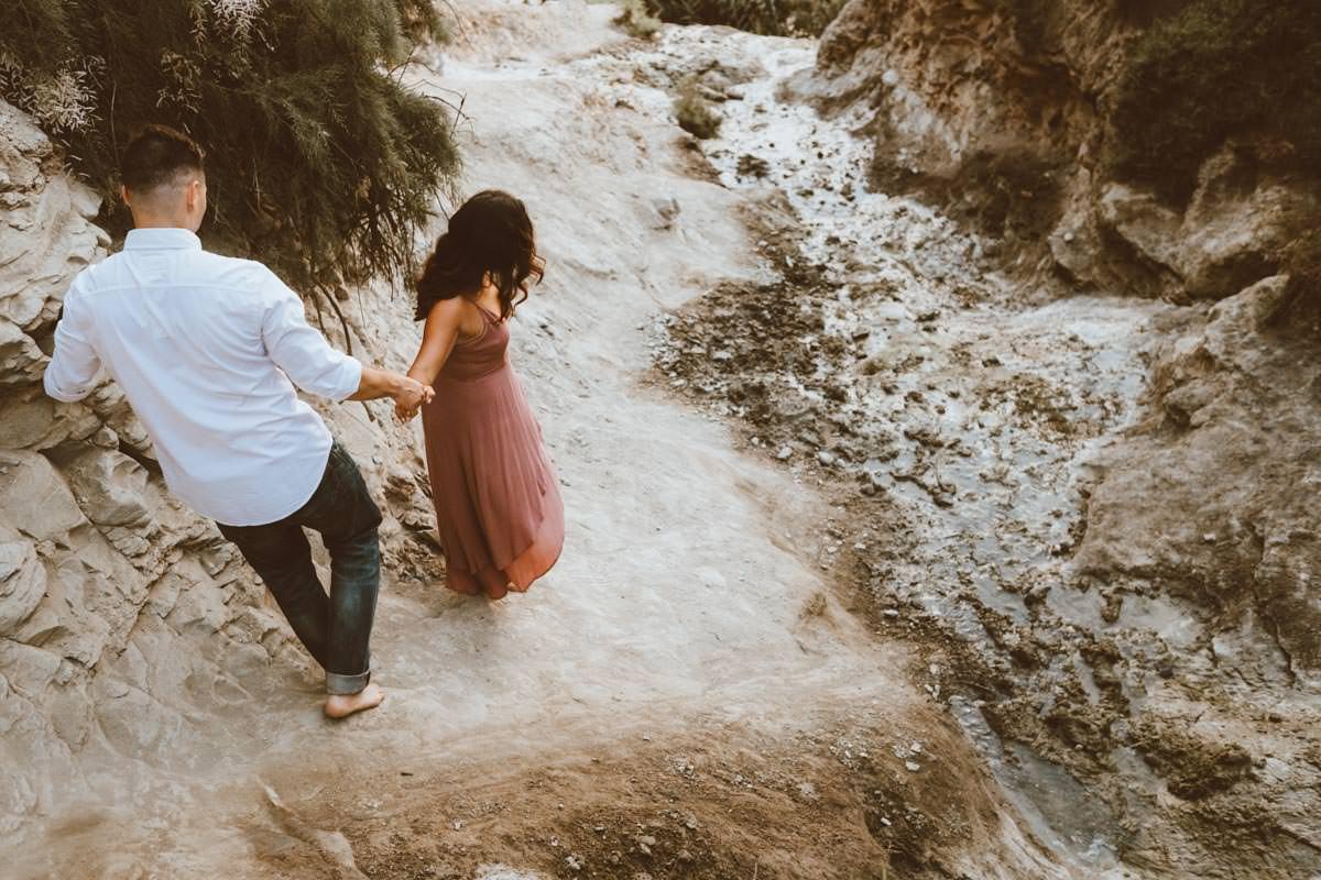 adventurous couple hiking barefoot for engagement session la jolla 35