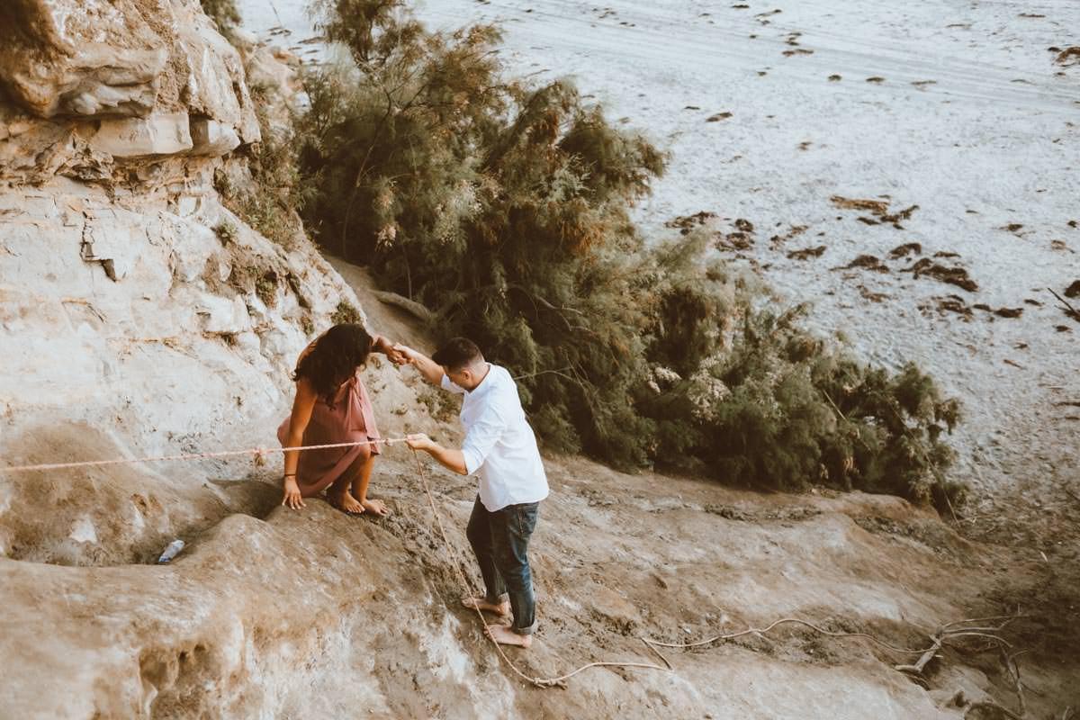 adventurous couple hiking barefoot for engagement session la jolla 36