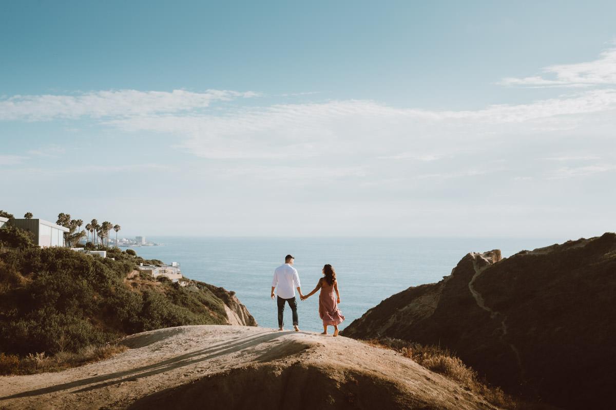 adventurous couple hiking barefoot in la jolla 2