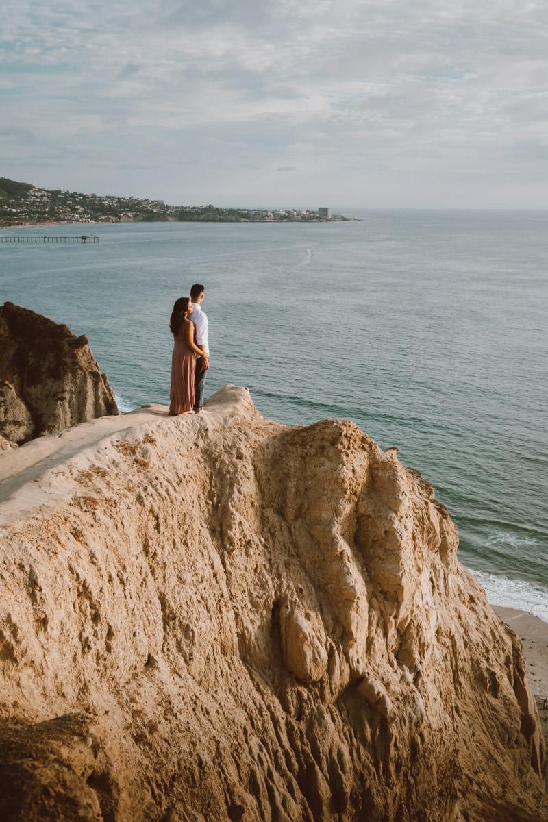 adventurous couple hiking barefoot in la jolla 5