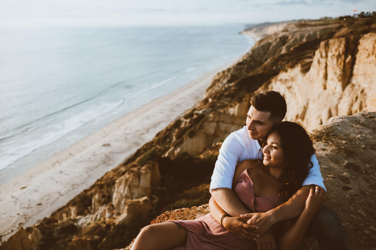 adventurous couple hiking barefoot for engagement session la jolla 8