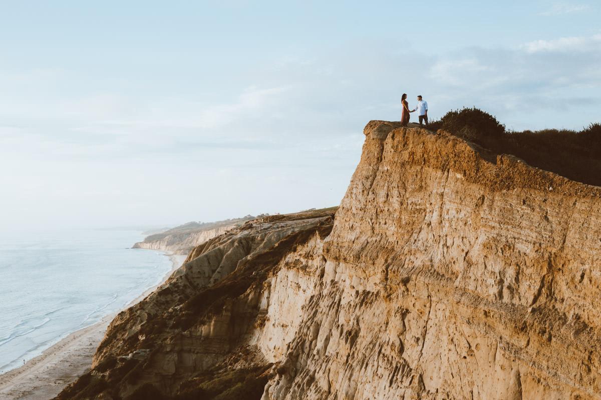 adventurous couple hiking barefoot for engagement session la jolla 13