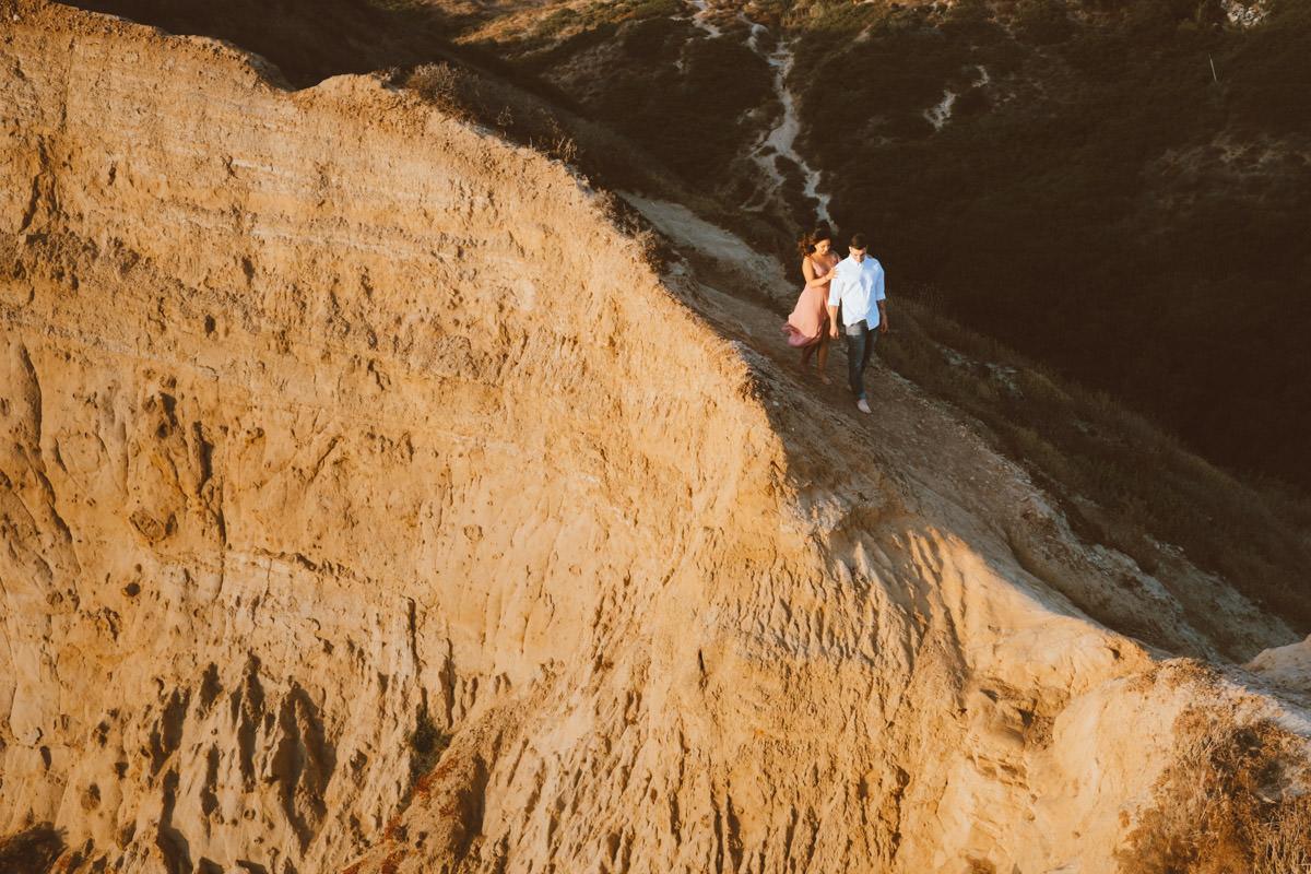 adventurous couple hiking barefoot for engagement session la jolla 14