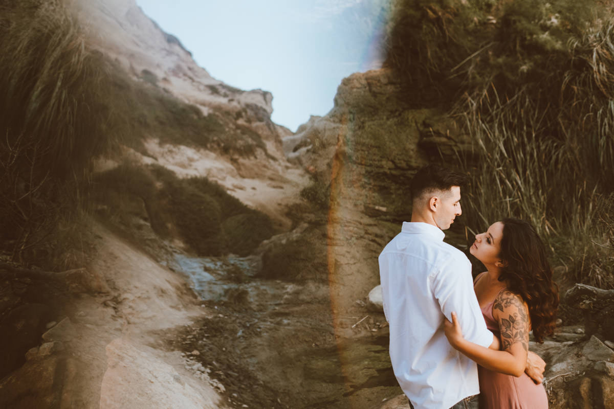 adventurous couple hiking barefoot for engagement session la jolla 17