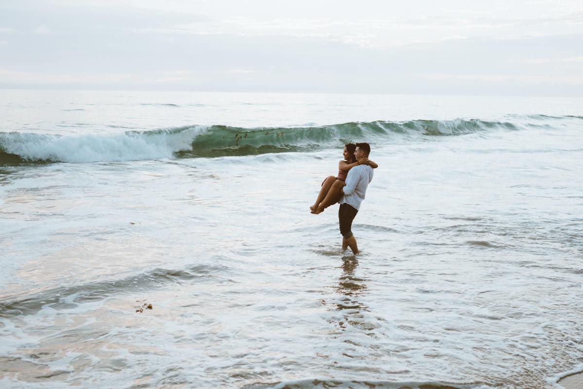 adventurous couple hiking barefoot for engagement session la jolla 19