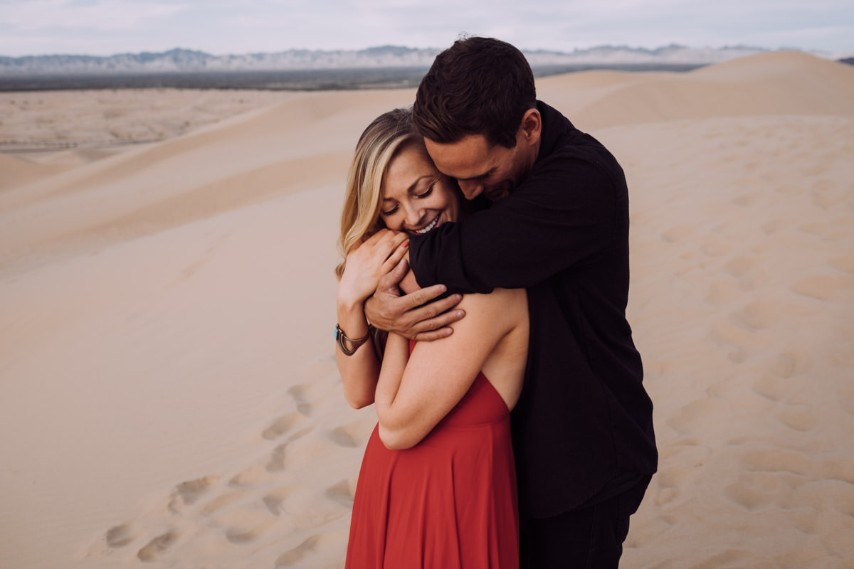San Diego top 7 amazing engagement session locations glamis imperial sand dunes engagement hug from behind