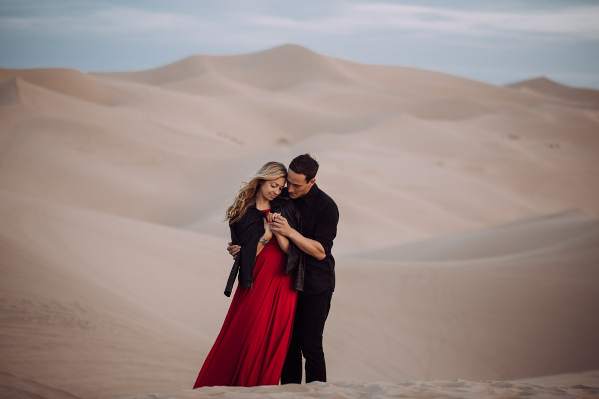 San Diego top 7 amazing engagement session locations glamis imperial sand dunes engagement couple holding hand