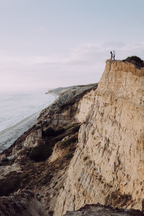 San Diego top 5 amazing engagement session locations standing of a cliff engagement at ho chi minh trail