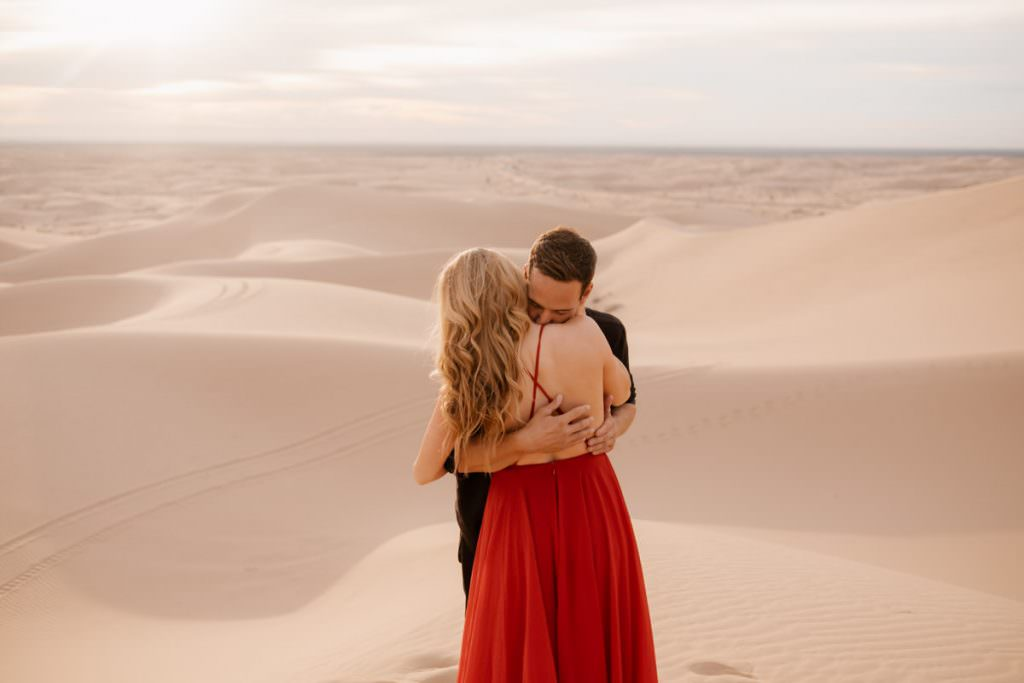 glamis sand dunes engagement session a warm hug
