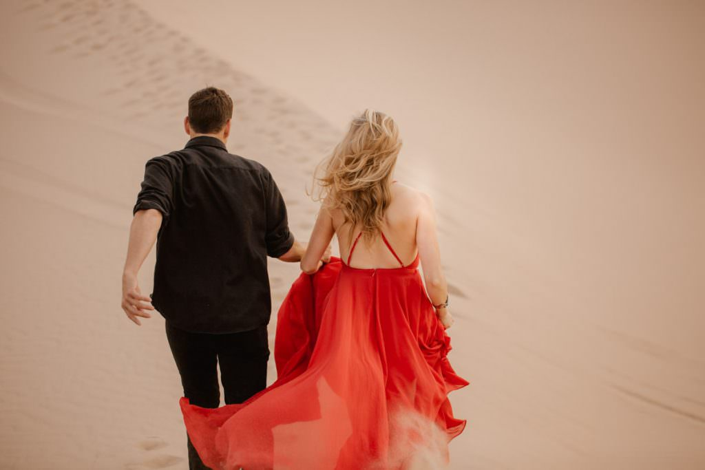 glamis sand dunes engagement session running on the sand