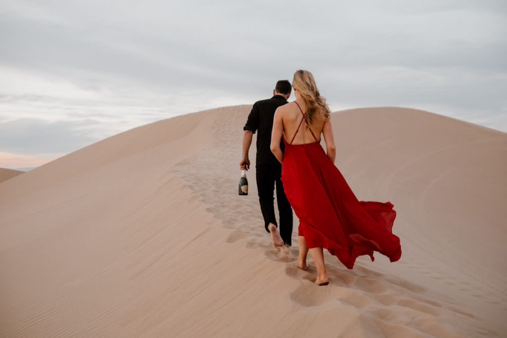 glamis sand dunes engagement session celebrate with champagne