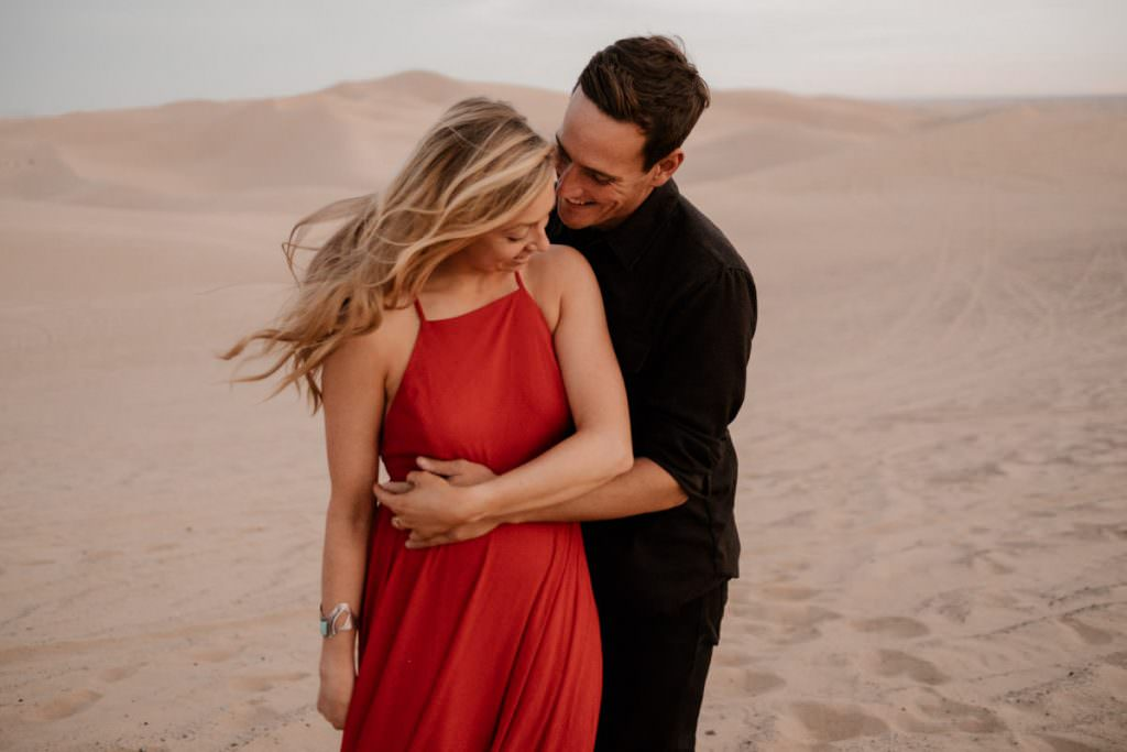 glamis sand dunes engagement session hold tight