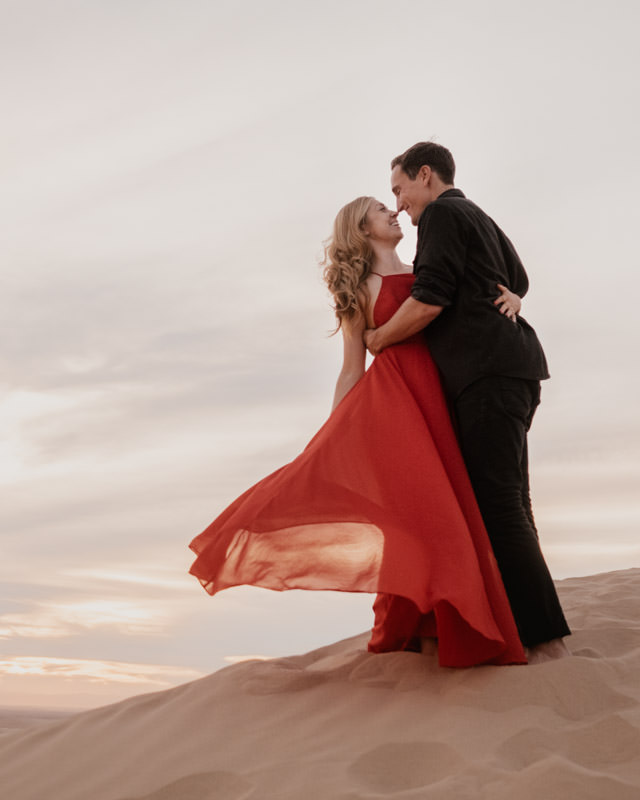 glamis sand dunes engagement session flipping the gorgeous dress