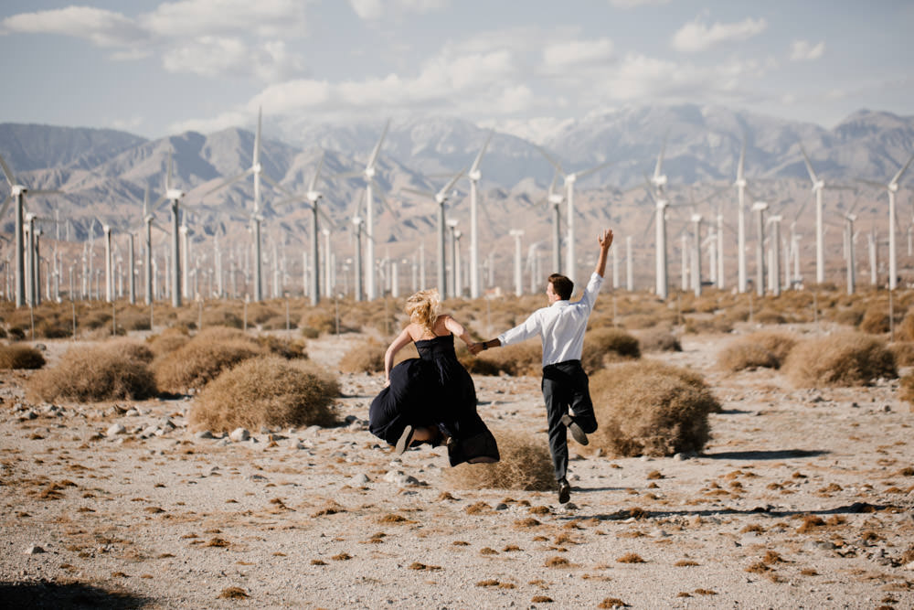 joshua tree + palm springs engagement jumping in joy