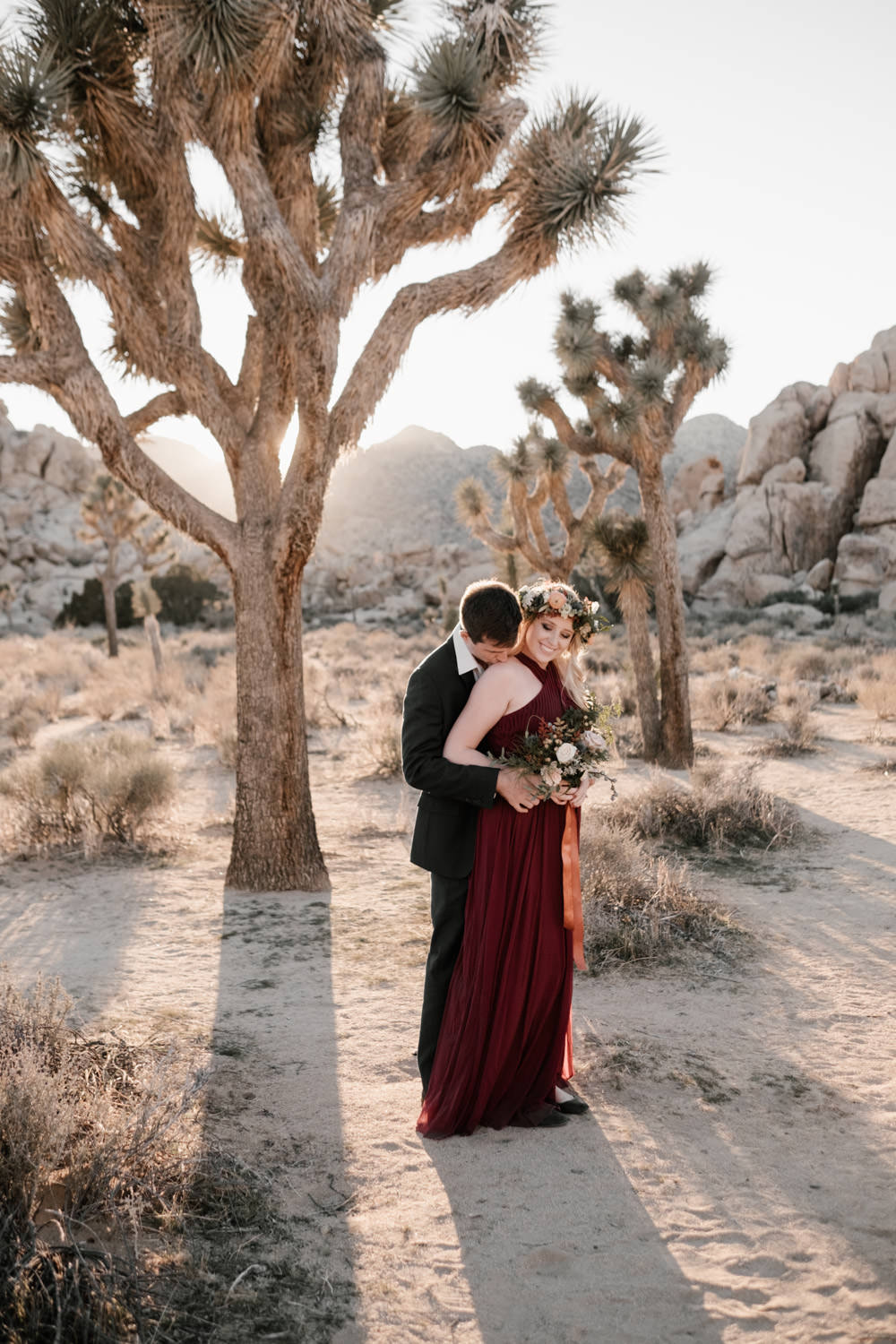 joshua tree + palm springs engagement a kiss on the shoulder