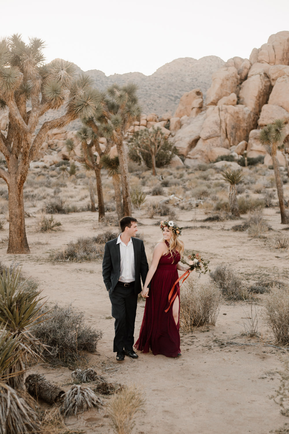 joshua tree + palm springs engagement holding each others hand