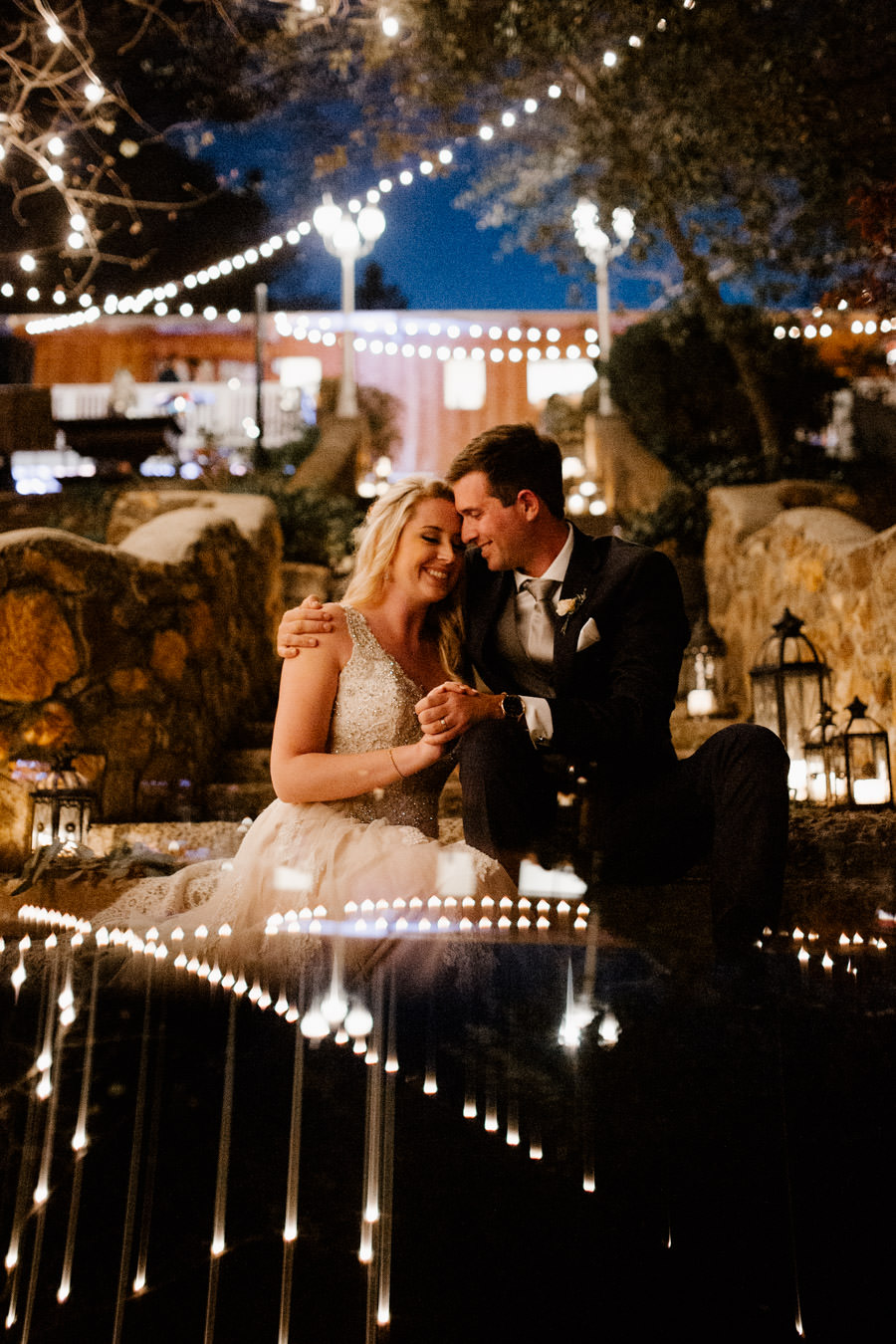 reception - moments in between intimate moments of bride and groom down the stairs with lanterns on their sides