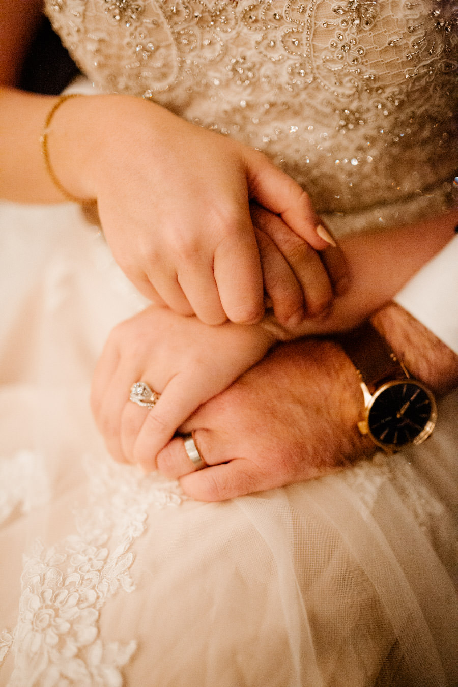 reception - moments in between wedding rings and newlyweds hands