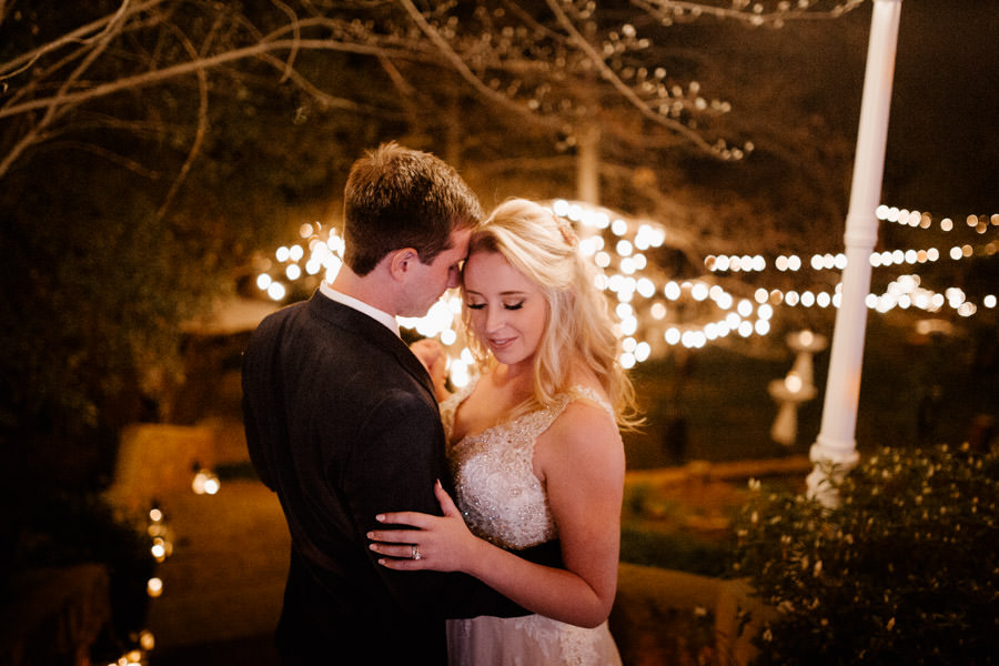 sacred mountain julian wedding romantic moment with string lights on the background