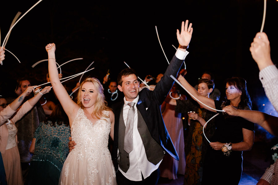 sacred mountain julian wedding formal exit with glowing sticks and everyone so happy