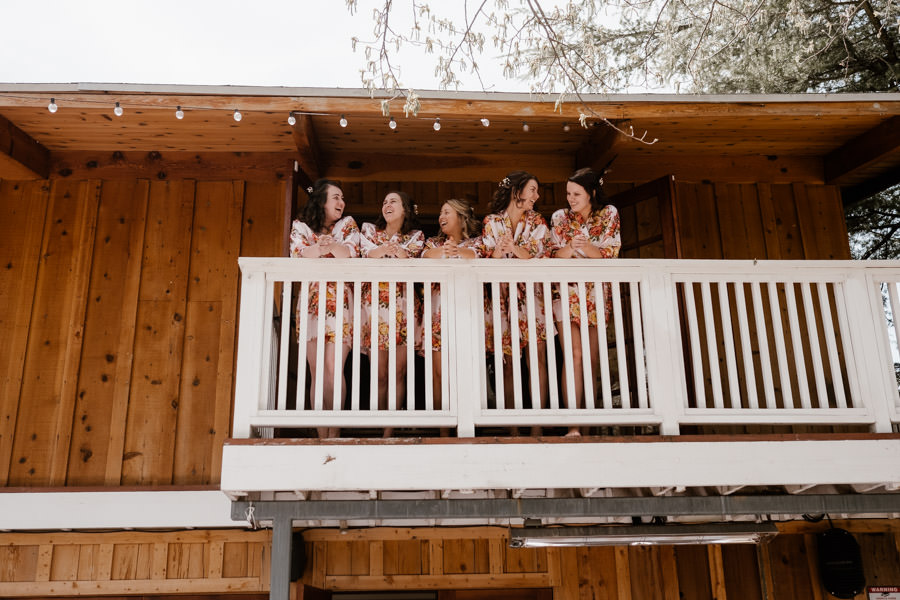 sacred mountain julian wedding girls getting ready and hang out on the balcony