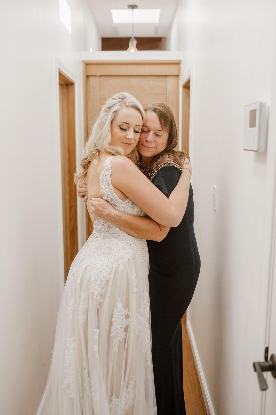 sacred mountain julian wedding mom and bride share an intimate moment