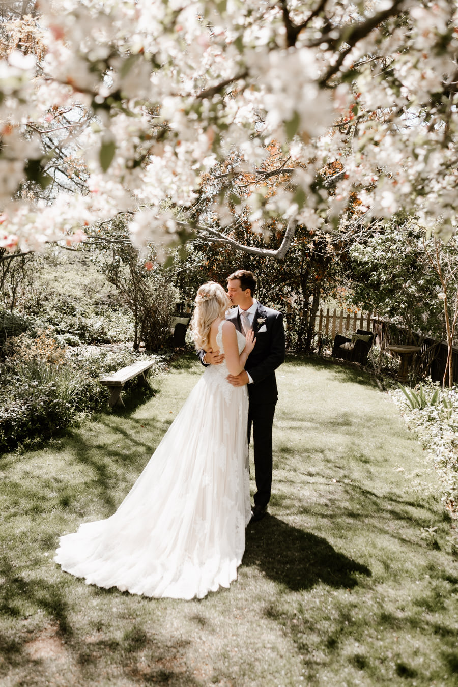 sacred mountain julian wedding first look and kiss under the cherry blossom