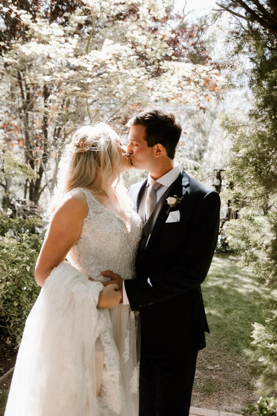 sacred mountain julian wedding sharing a sweet kiss under beautiful sunlight