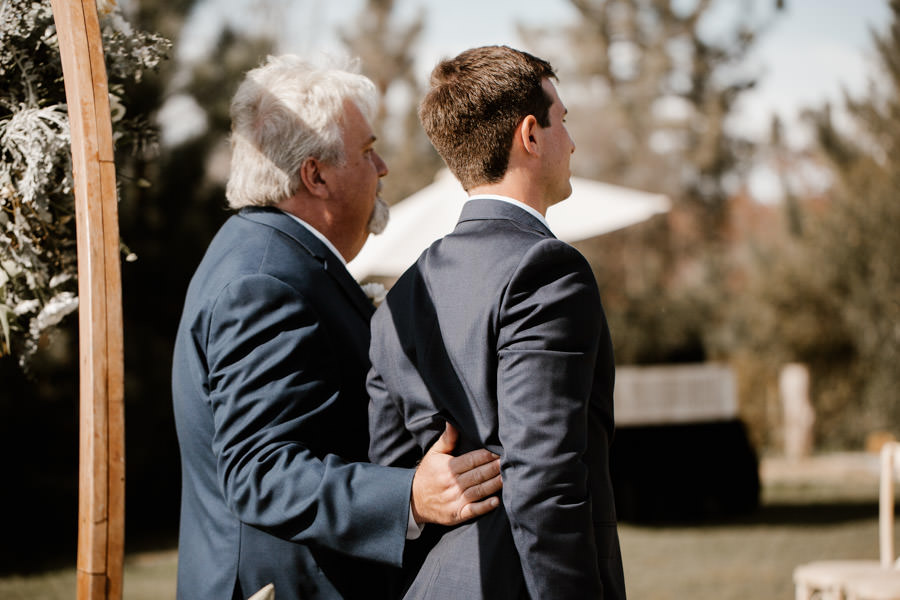 son and dad holding on to each other