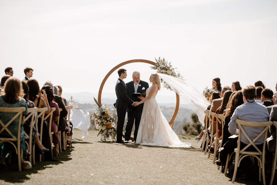 ceremony with dreamy light bride and groom and their loved ones
