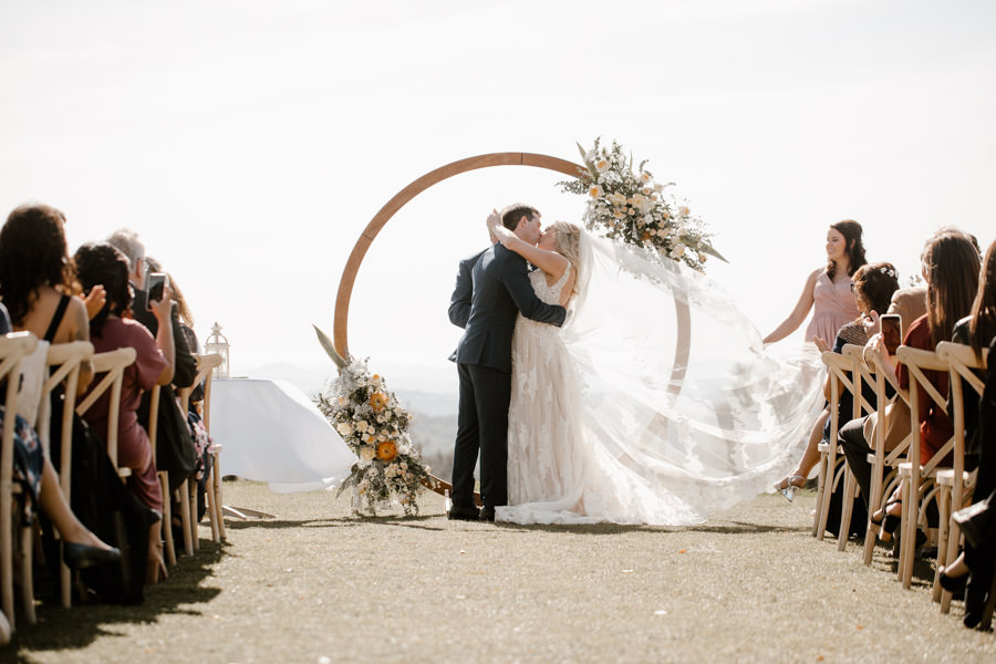 sacred mountain julian wedding bride and groom first kiss