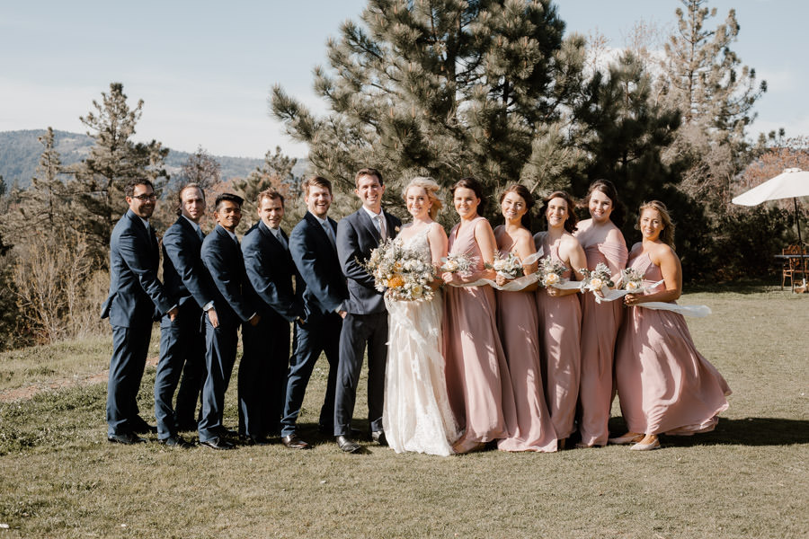 bride and groom and their bridal party after ceremony