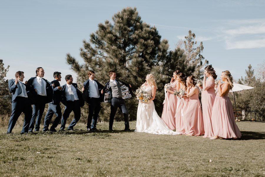 bride and groom having fun during bridal party photo