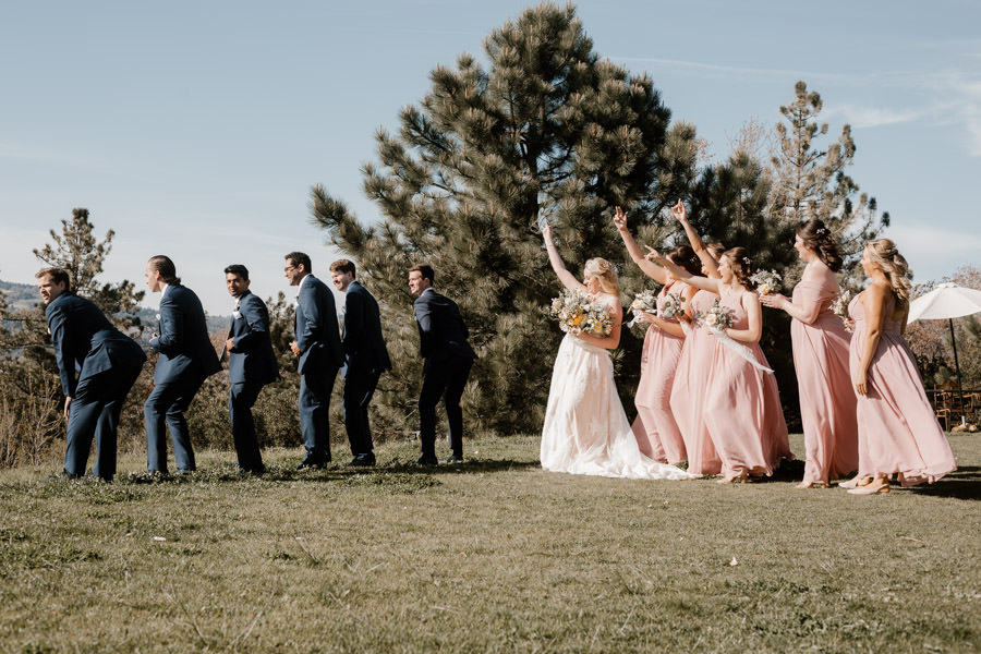 bride and groom playing with their bridal party