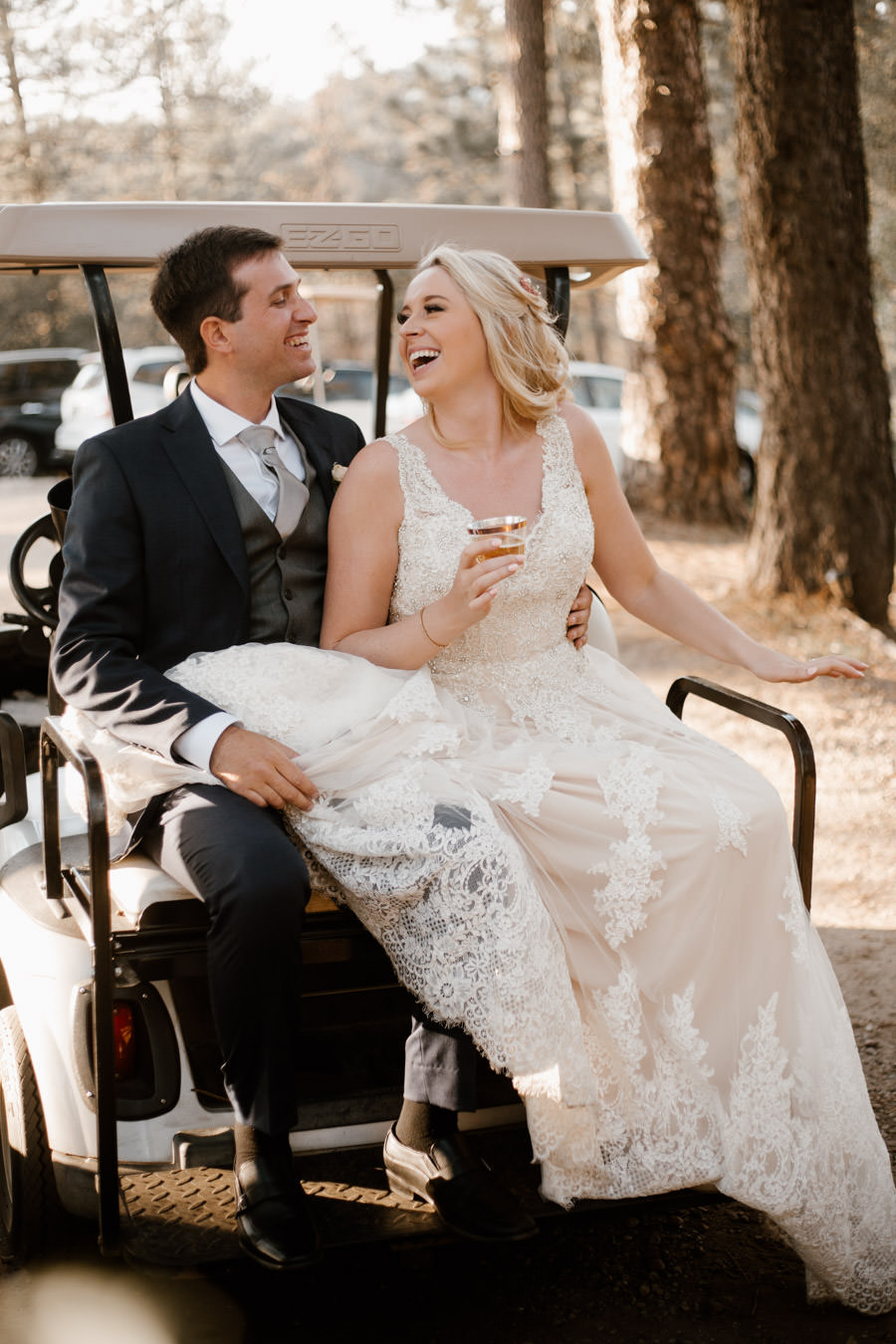 bride and groom on the cart laughing and being happy ready for their sunset photos