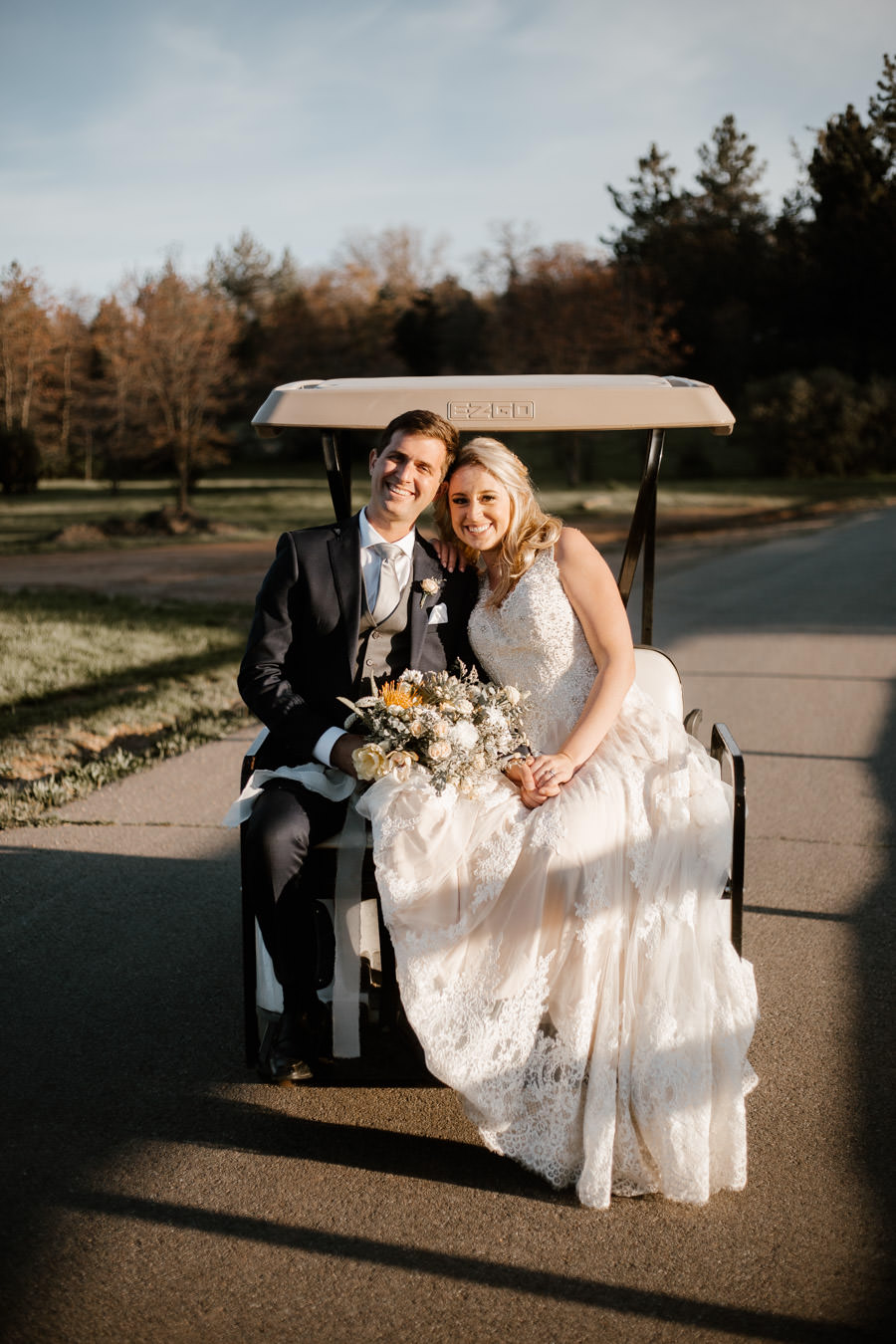 bride and groom sunset portrait on the cart to a new spot