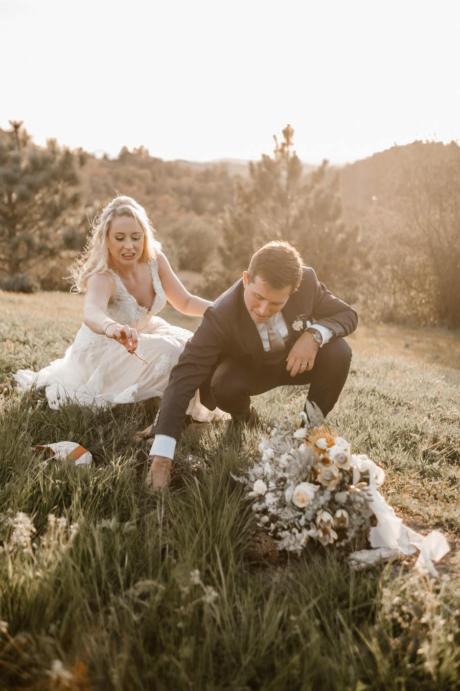 sacred mountain julian wedding bride and groom sunset portrait digging the bourbon bottle