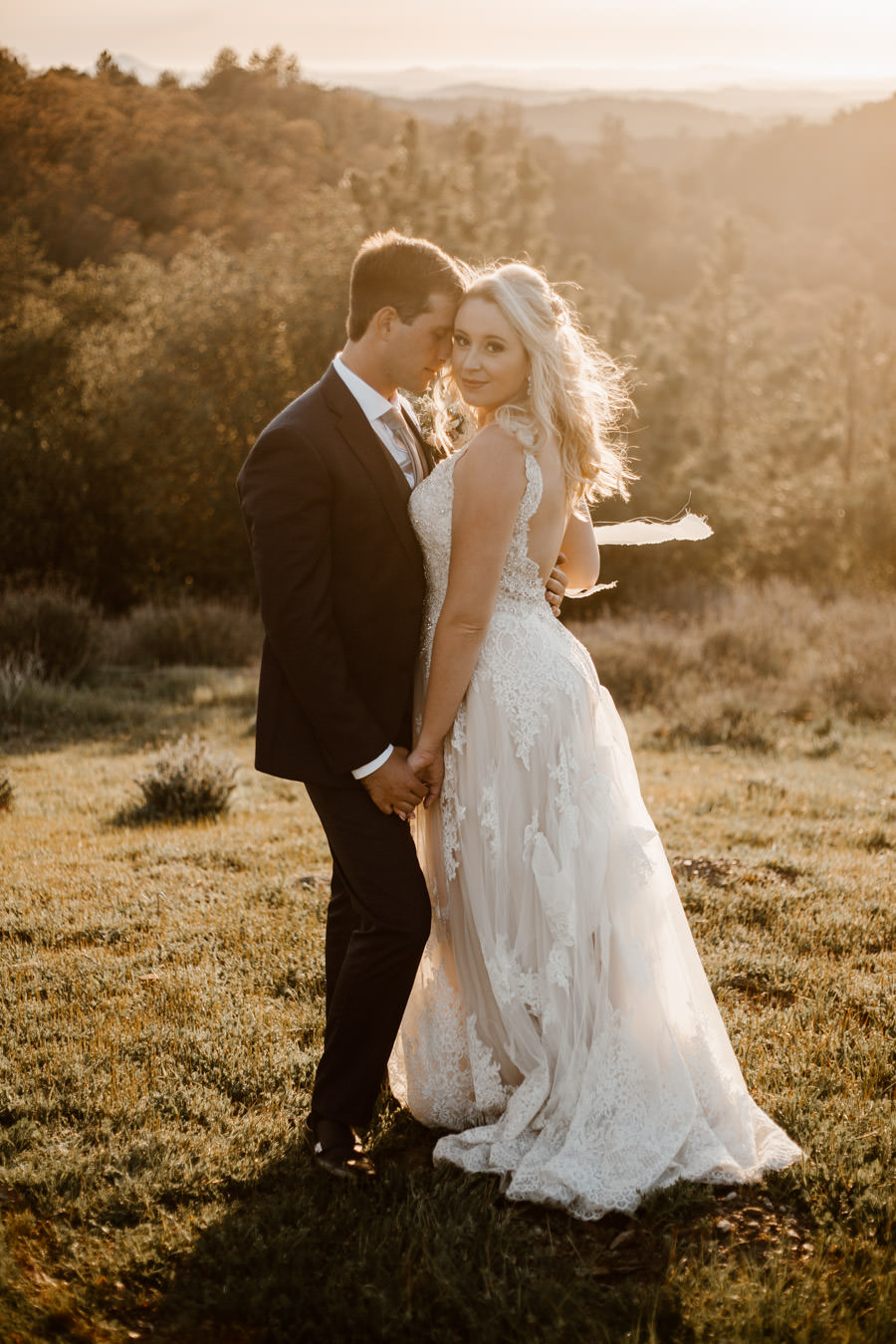sacred mountain julian wedding bride and groom sunset portrait with mountain ranges on the background