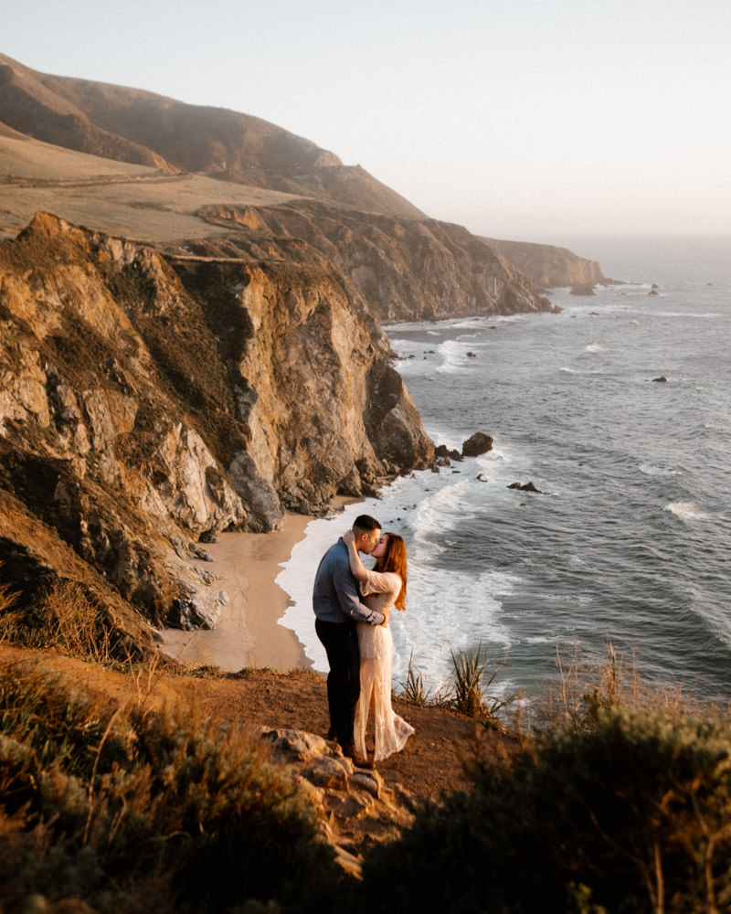 big sur engagement session stunning sunset and amazing landscape and loving couple
