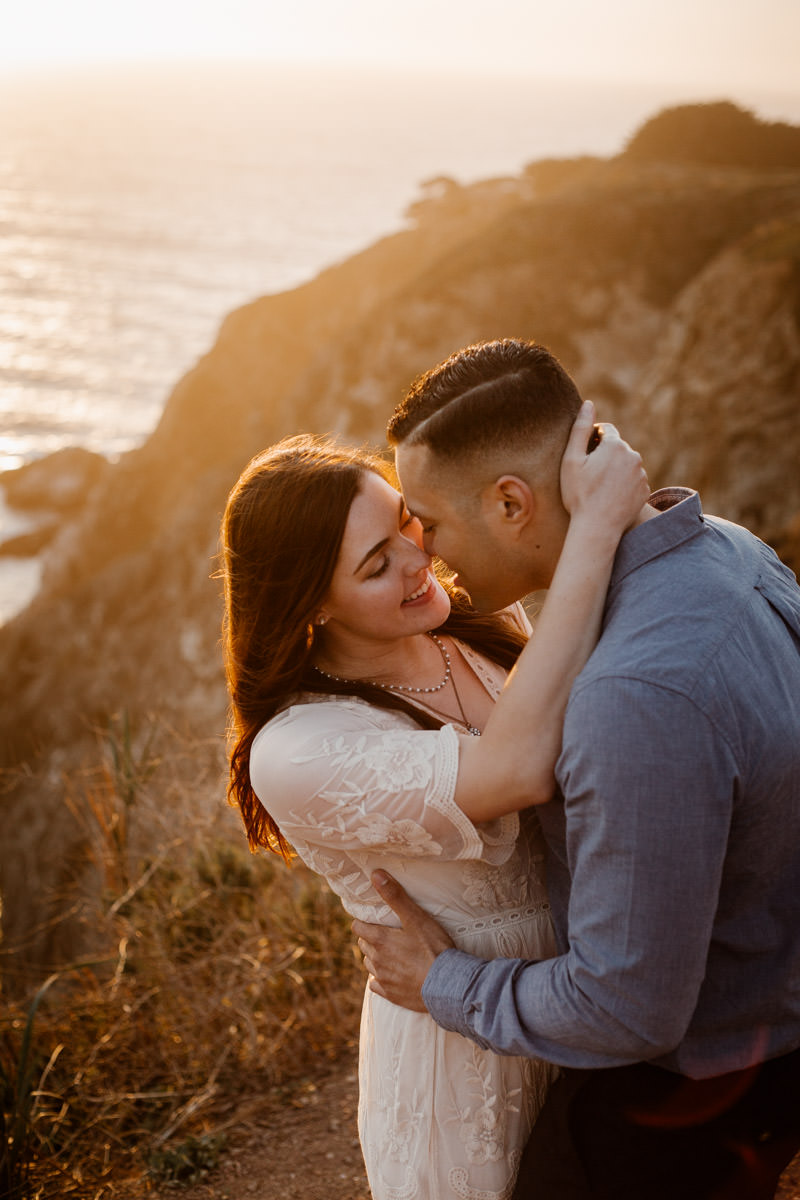 big sur engagement session sweet moment at sunset