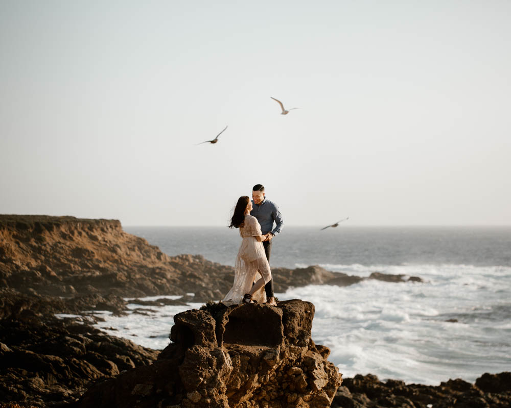 California top 33 epic engagement photography locations standing on a cliff with ocean view