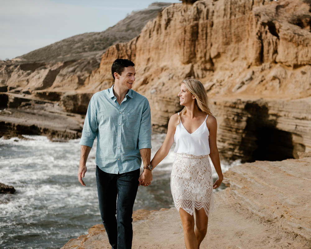 California top 33 epic engagement photography locations cabrillo national monument walking on a cliff