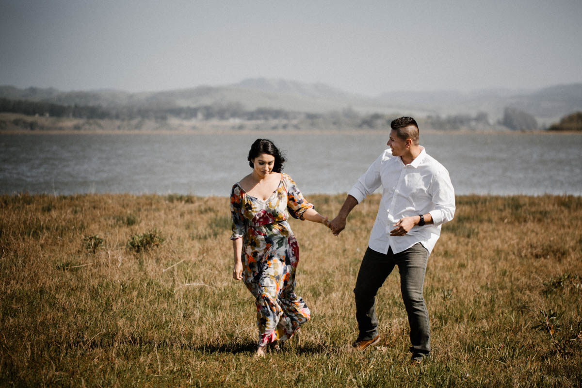 point reyes engagement photos playing by the lake