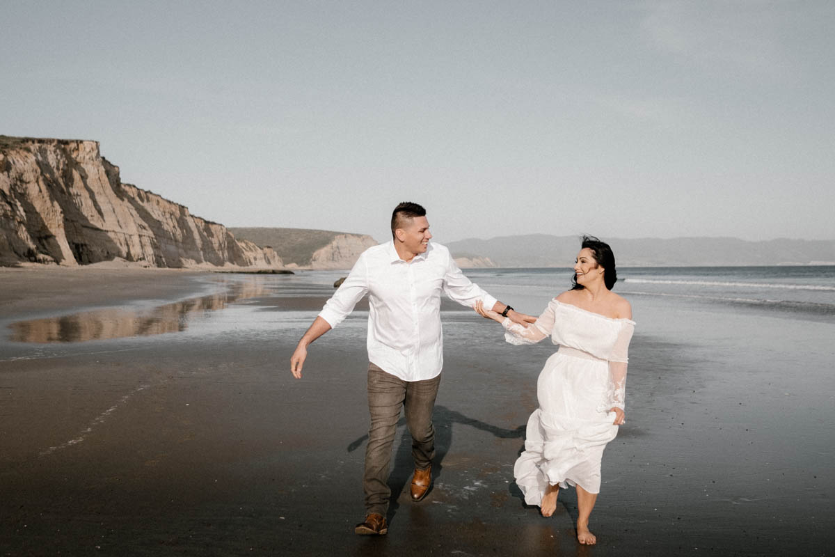 point reyes engagement session playing on the beach