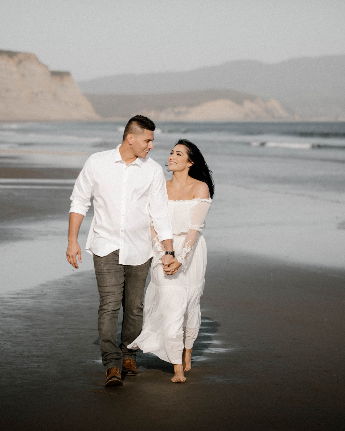 point reyes engagement session walking on the beach