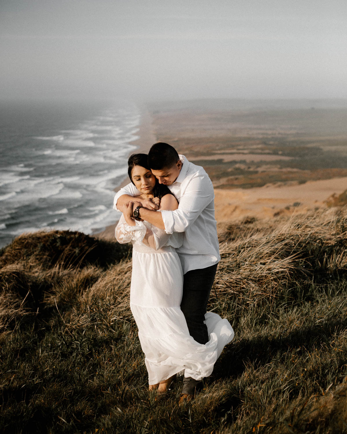 point reyes engagement shoot hold each other tight