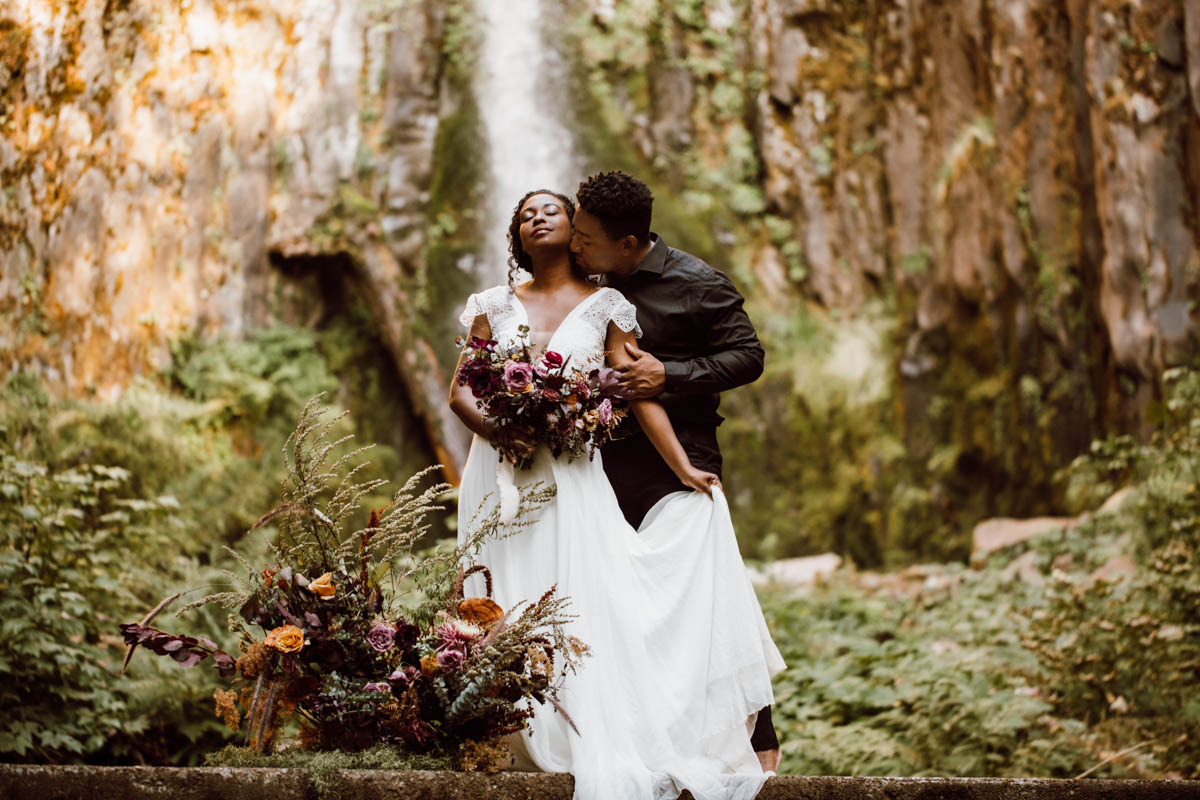 columbia river gorge elopement intimate moment under waterfalls