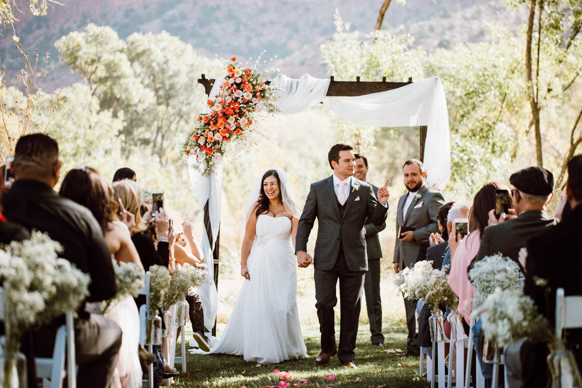 zion national park wedding walking down the aisle as husband and wife