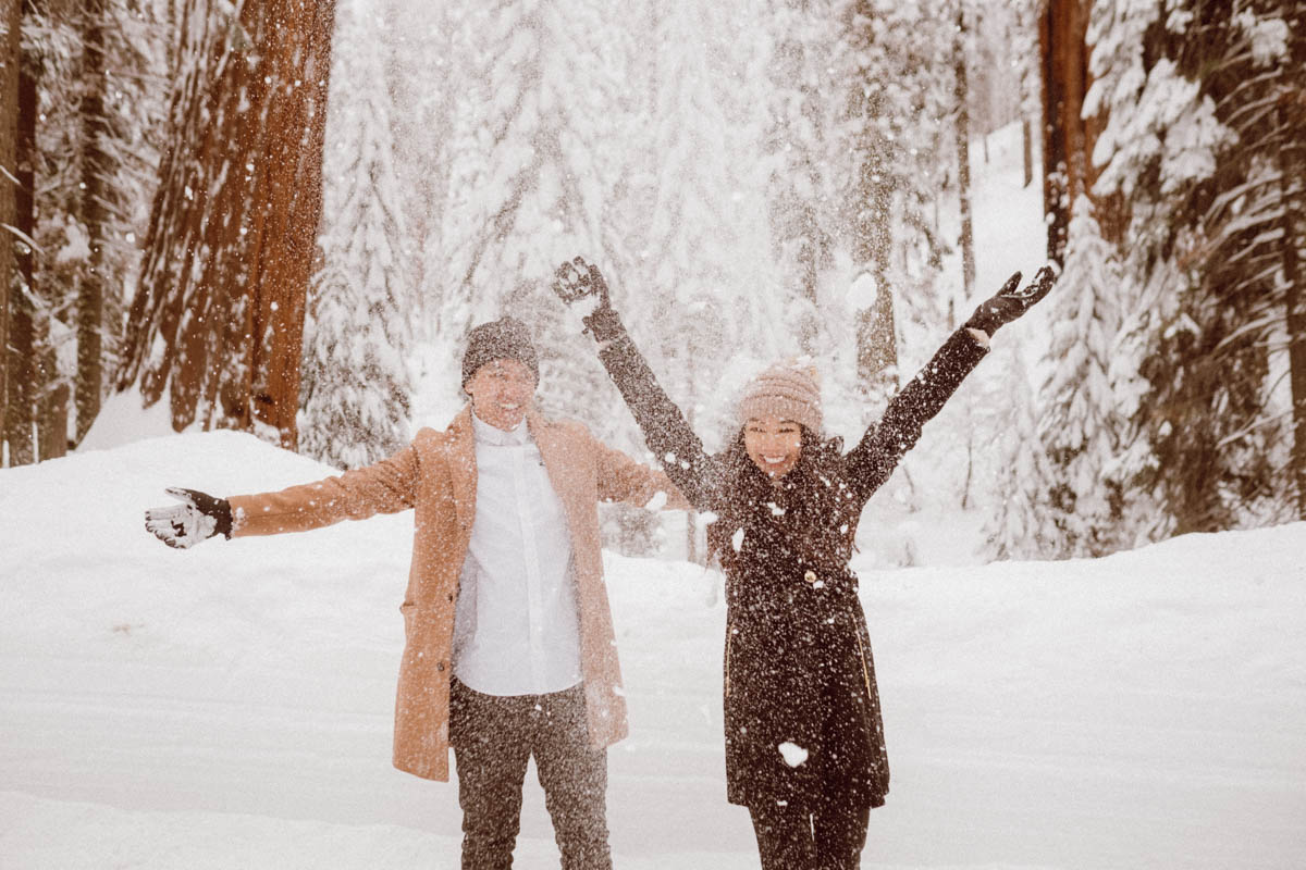 sequoia national park engagement session playing with snow